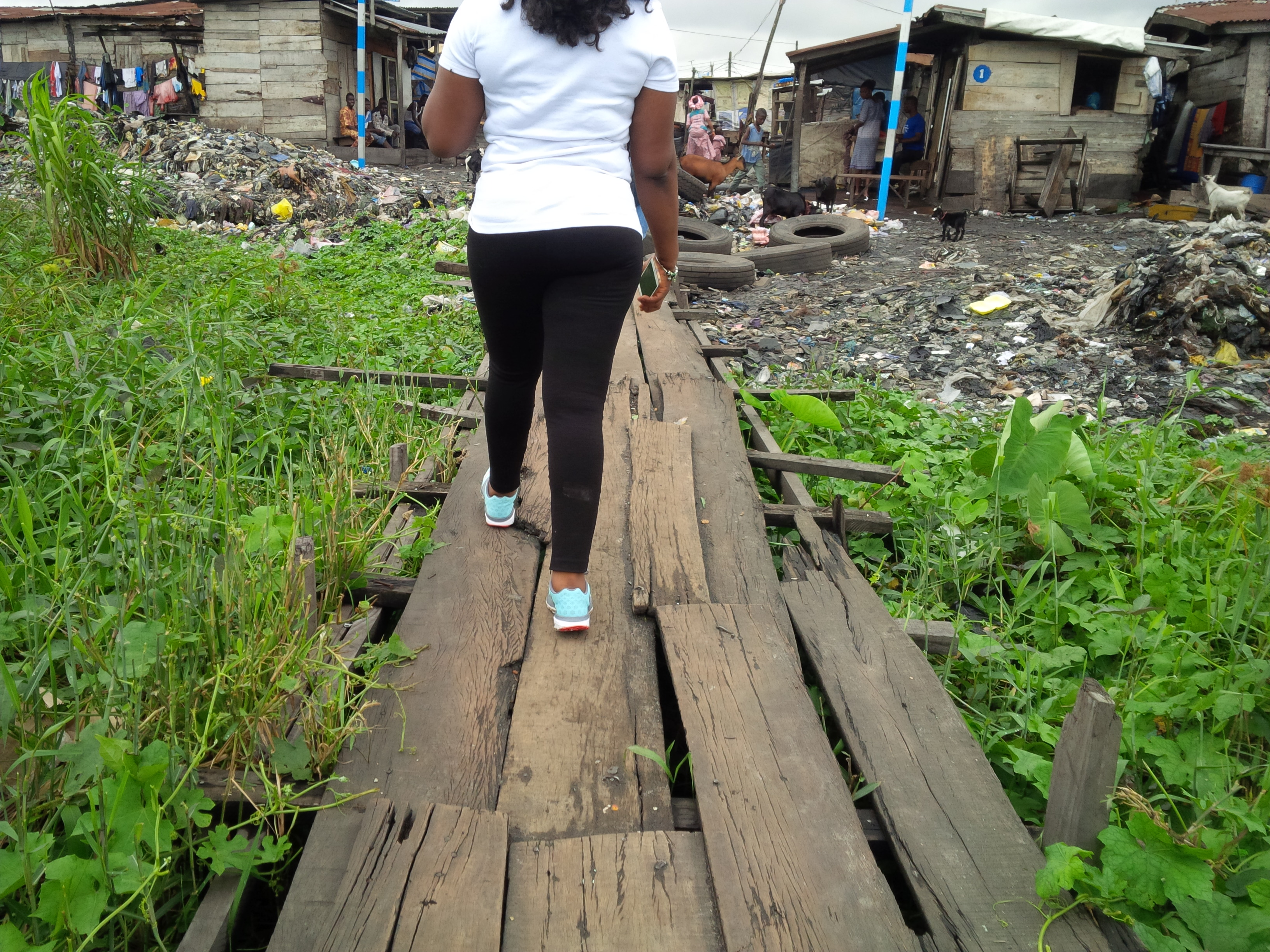Locally constructed bridge with planks. We paid N10/person to use this bridge.